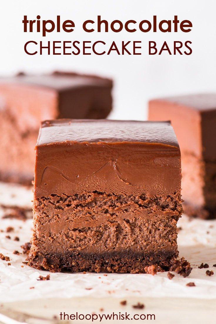Triple Chocolate Cheesecake Bars (Gluten Free) - These triple chocolate cheesecake bars are every chocoholic's dream come true. Creamy, intensely chocolatey and just all round delicious, as well as easy to make… and oh-so decadent. Gluten free cheesecake. Chocolate dessert recipes. Small batch recipe. Chocolate ganache. Chocolate cheesecake base. Easy dessert recipe. Chocolate recipes. Cheesecake recipes. #chocolate #cheesecake