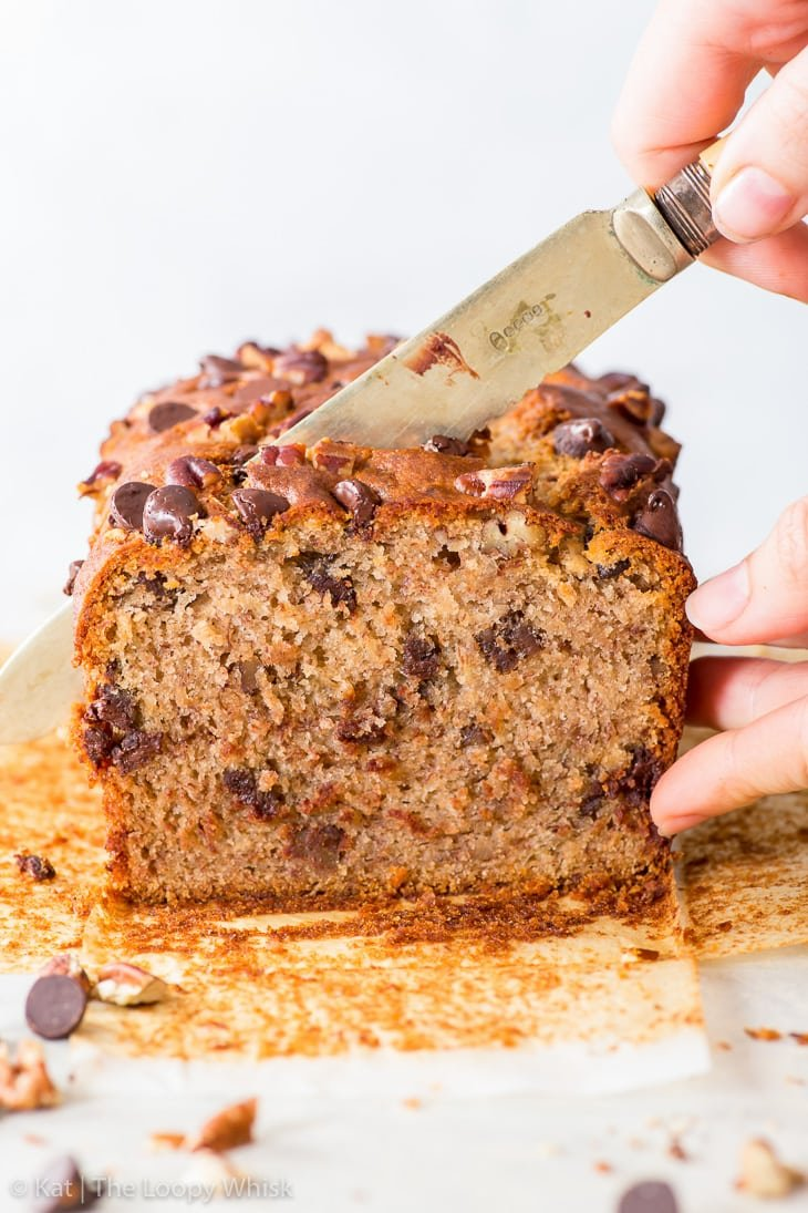 Cutting a piece of the vegan banana bread.