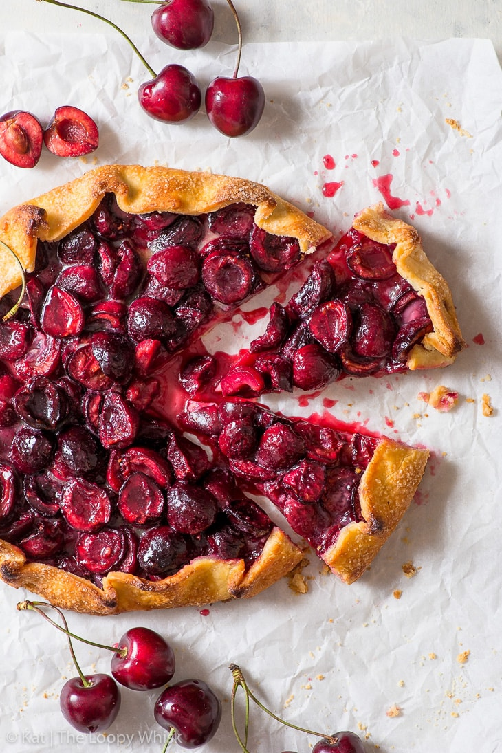 Overhead view of cherry galette with two pieces having been cut.