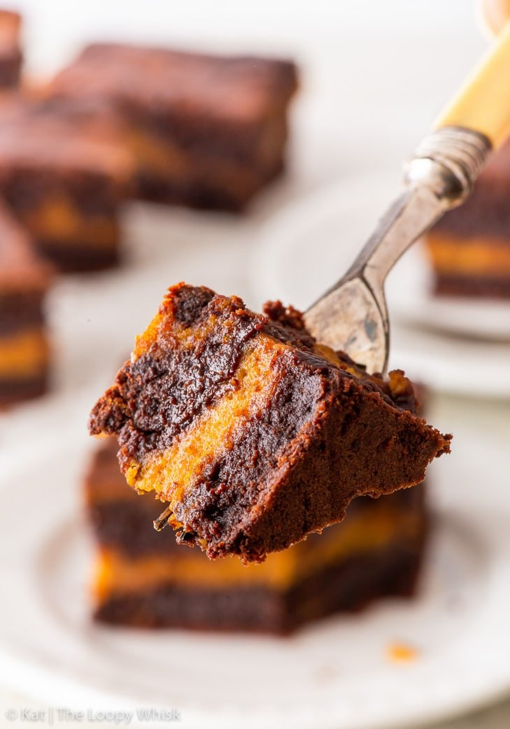 Close-up of a bite of pumpkin brownie on a dessert fork.