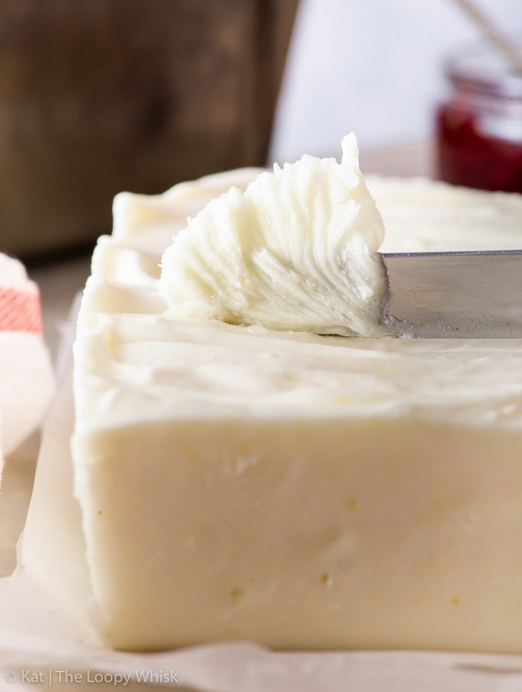 Close-up of vegan butter being scooped with a knife.