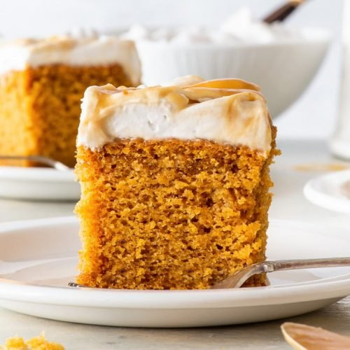 Vegan Pumpkin Cake with Butterscotch Swirl Frosting [SPONSORED] - This vegan pumpkin cake just might be the perfect vegan fall dessert. With a moist, fluffy vegan sponge full of pumpkin puree and spices, and a coconut cream frosting swirled through with a luscious butterscotch sauce, this vegan cake ticks all the boxes. Vegan frosting. Vegan dessert. Vegan recipes. Pumpkin recipes. Pumpkin spice recipes. Pumpkin desserts. Fall recipe ideas. #pumpkin #vegancake