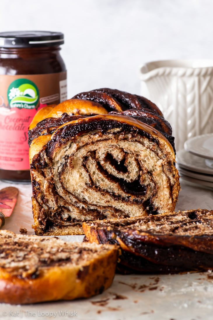 Head-on view of the vegan chocolate babka, with a few pieces having been cut.