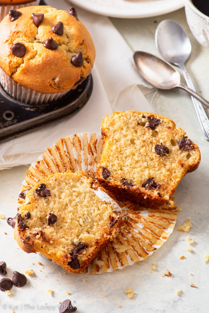 A gluten free chocolate chip muffin cut in half.