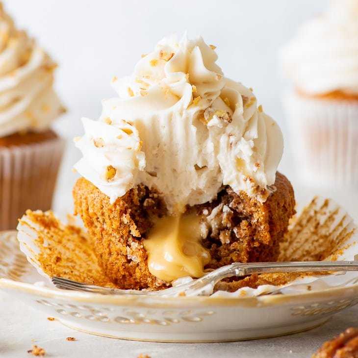 Vegan Maple & Pecan Cupcakes [SPONSORED] - These vegan maple & pecan cupcakes will set off fireworks on your taste buds, with melt-in-the-mouth pecan cupcakes, a fluffy maple frosting and a centre of luscious maple spread. Plus, the recipe has no egg replacements, and did I mention the cupcakes are absolutely gorgeous? Vegan cupcakes. Vegan buttercream frosting. Vegan dessert recipes. Dairy free cupcakes. Maple syrup recipes. Pecan recipes. #vegan #cupcakes