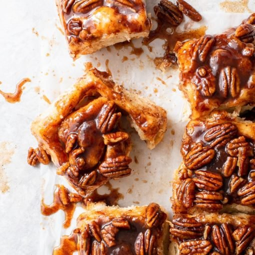 Vegan Cinnamon & Pecan Sticky Buns [SPONSORED] - These vegan sticky buns are vegan comfort food at its best. They're pillowy soft, drenched in the most amazing cinnamon and maple syrup caramel, and the addition of pecans adds a wonderful crunchy texture. Plus, they're surprisingly easy to make! Vegan cinnamon rolls. Vegan dessert. Vegan breakfast recipes. Vegan caramel. Plant based recipes. Breakfast ideas. Brunch recipes. #vegan #cinnamonrolls #stickybuns
