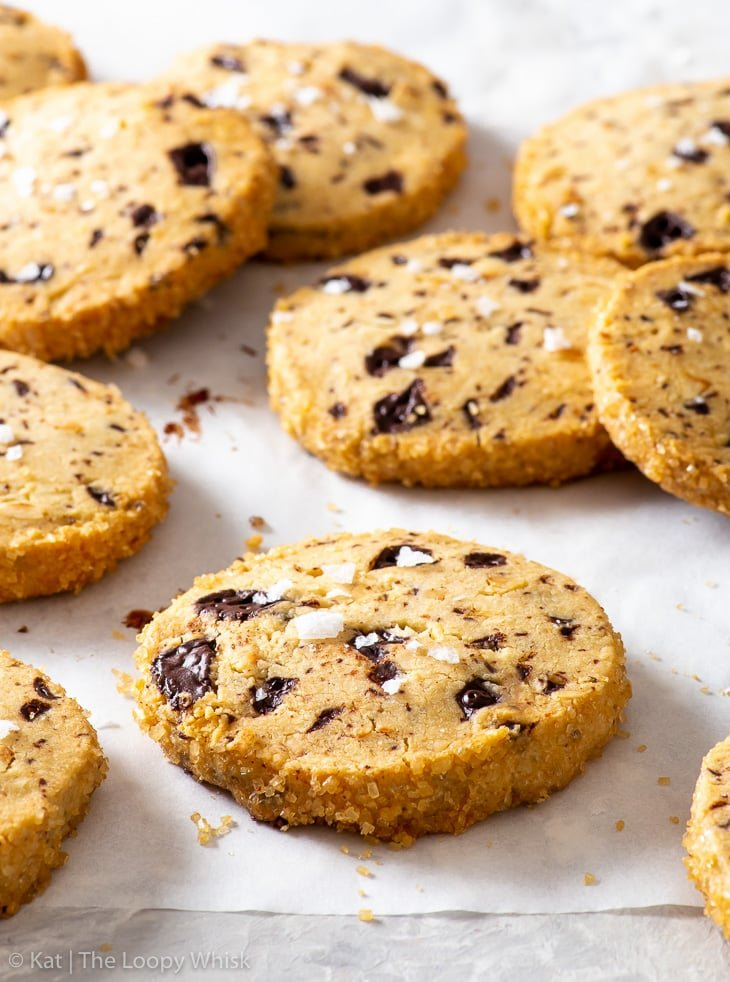 Slice and bake cookies, sprinkled with flaky sea salt, on a piece of white parchment paper.