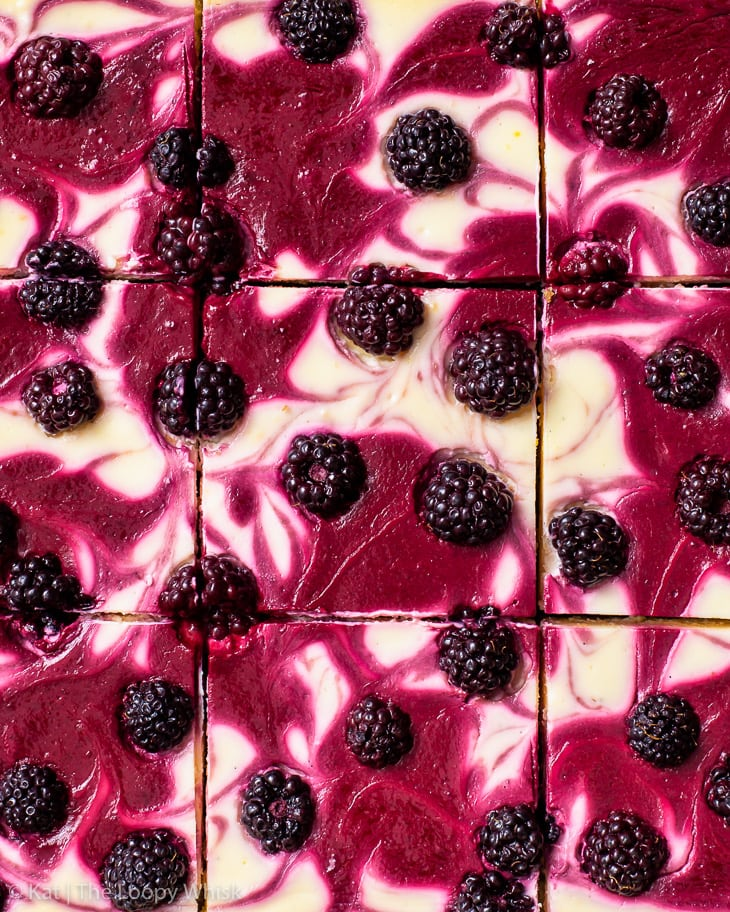 Overhead view of the cut blackberry cheesecake bars.