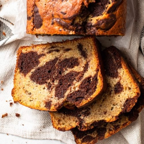 Overhead view of the marbled banana bread, with a few slices cut.