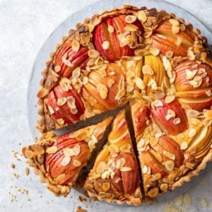 Overhead view of the apple tart with two pieces cut.