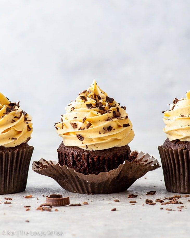 Three hazelnut chocolate cupcakes in a row.