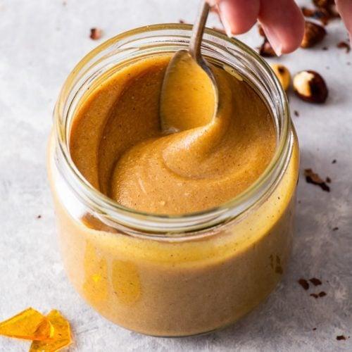 Stirring a jar of hazelnut praline paste.