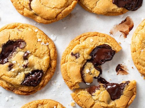 Chocolate chip cookies on white baking paper.
