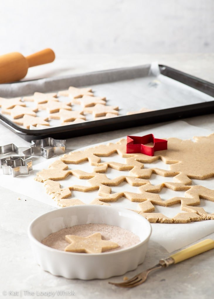 The process of cutting out star-shaped shortbread cookies.