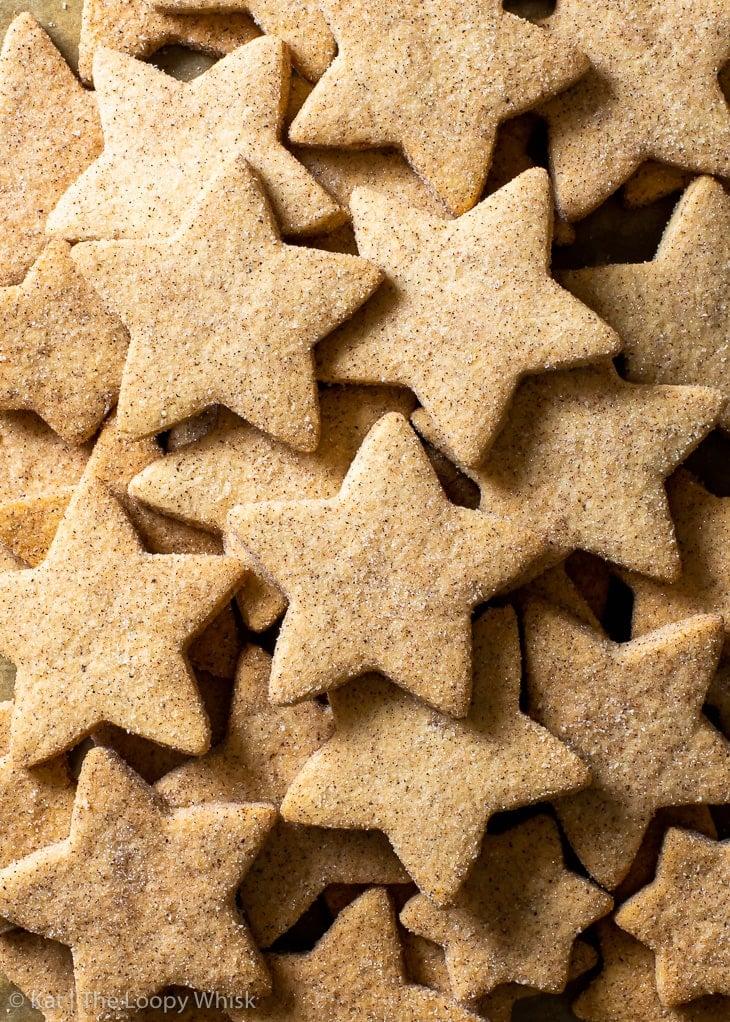 Overhead view of star-shaped gluten free cinnamon shortbread cookies.