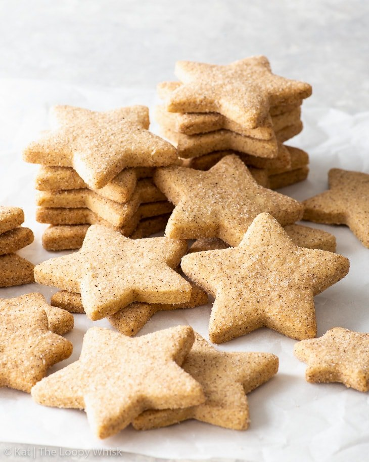 Stacks of star-shaped cinnamon shortbread cookies.
