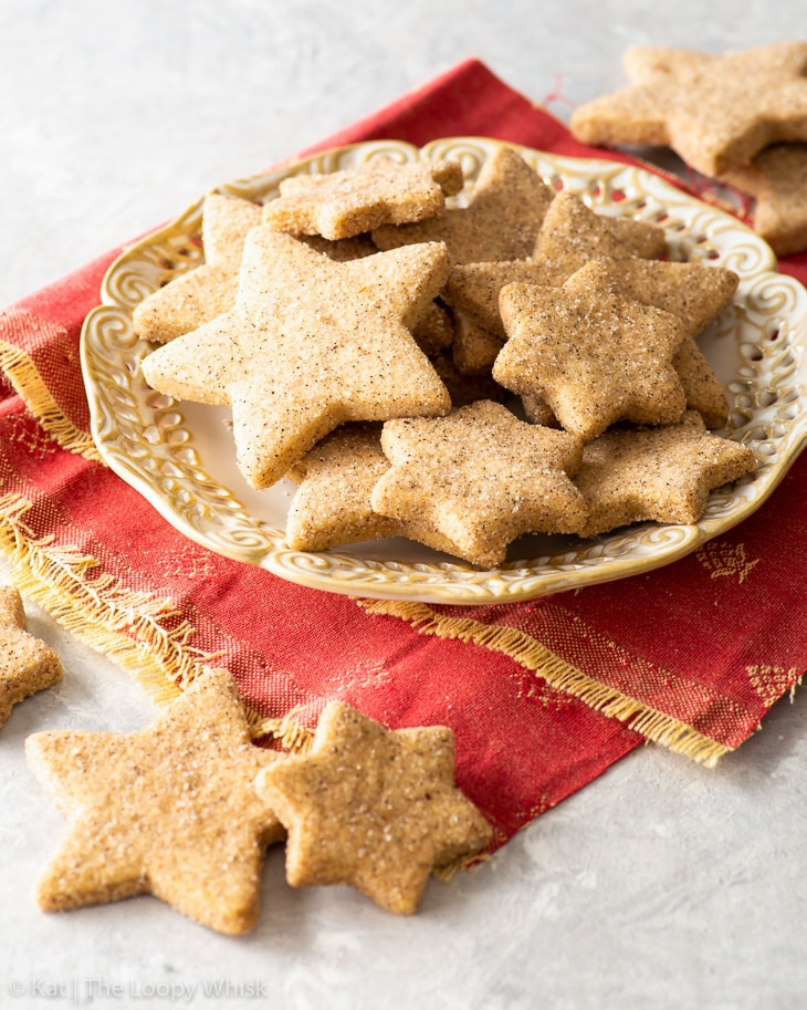 Star-shaped shortbread cookies on a dessert plate.