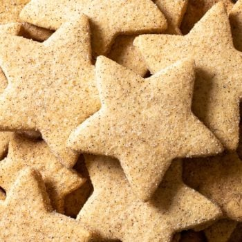 Overhead view of star-shaped gluten free cinnamon shortbread cookies.