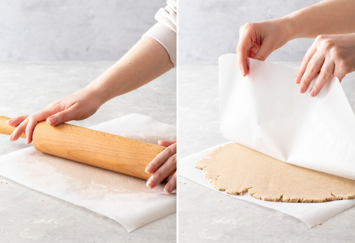 Rolling out gluten free shortbread cookie dough between two sheets of baking paper.