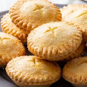 Gluten free mince pies on a grey plate.
