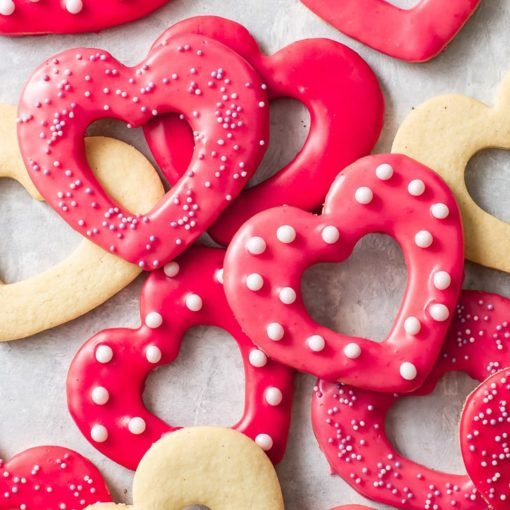 Overhead view of decorated heart-shaped Valentine's Day cookies.