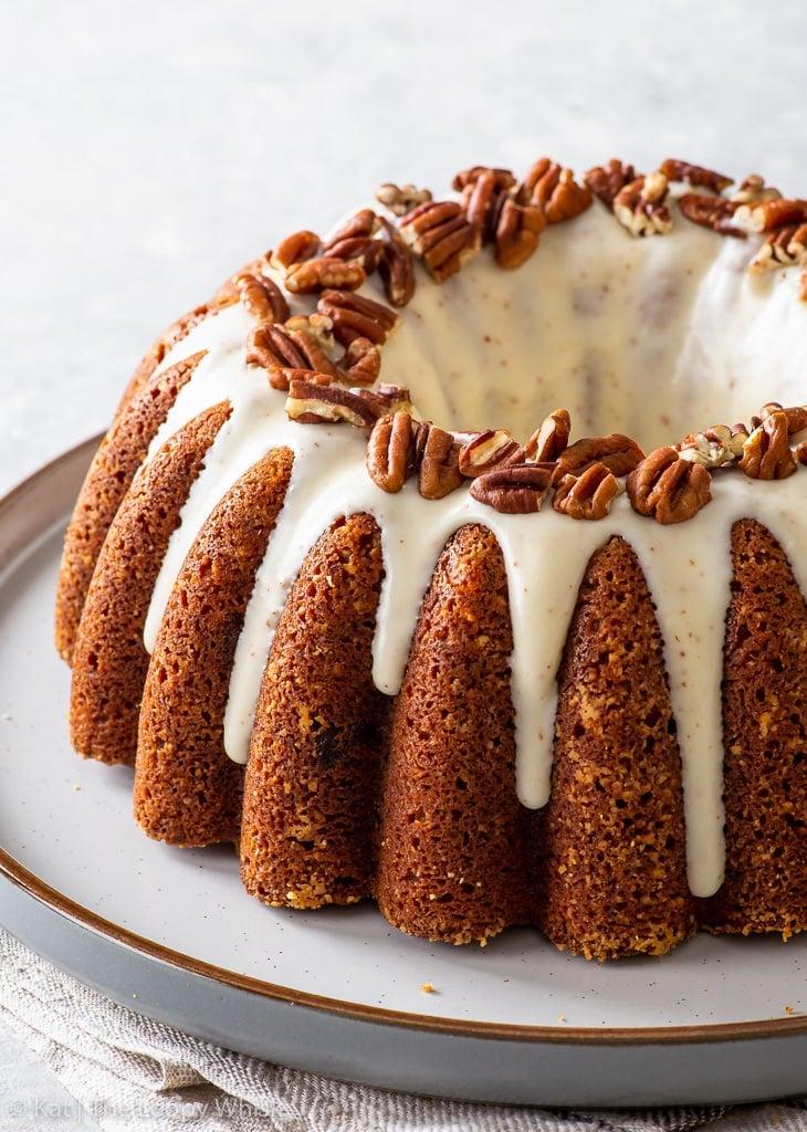Banana bundt cake on a large dessert plate.
