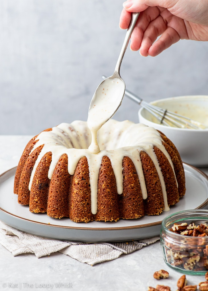 Icing the banana bundt cake with brown butter cream cheese icing.