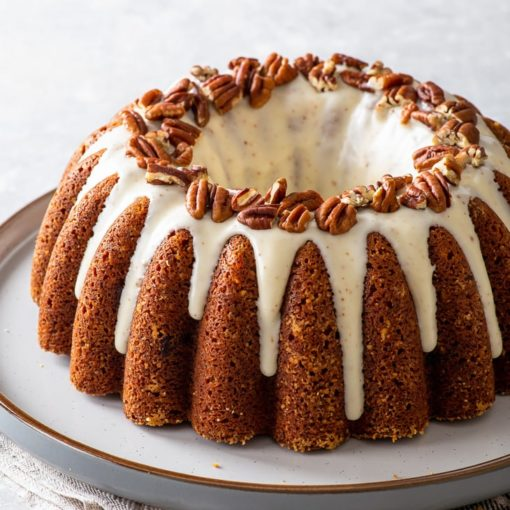 Banana bundt cake on a large dessert plate.
