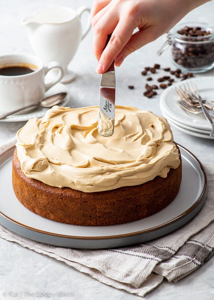 Decorating the coffee cake with cappuccino whipped cream frosting.