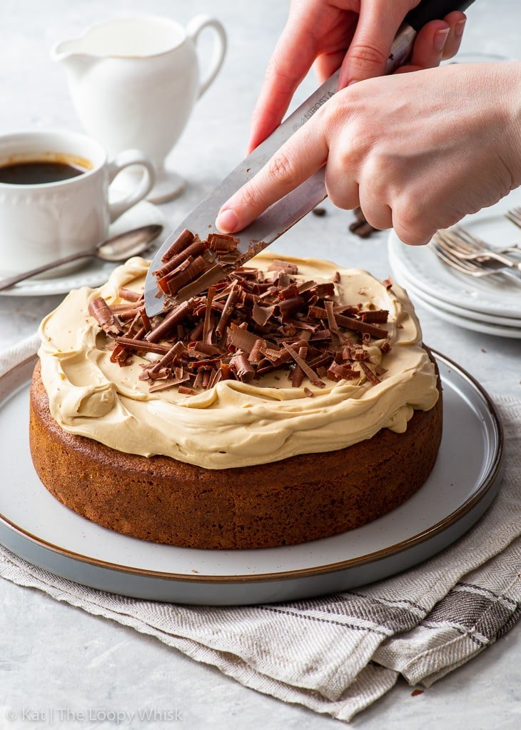 Decorating the frosted coffee cake with chocolate shavings.