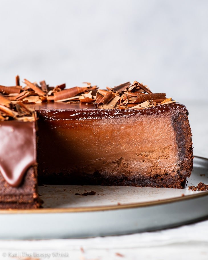Close-up of the triple chocolate cheesecake cross-section.