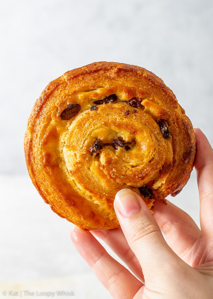 A hand holding a gluten free Danish pastry.