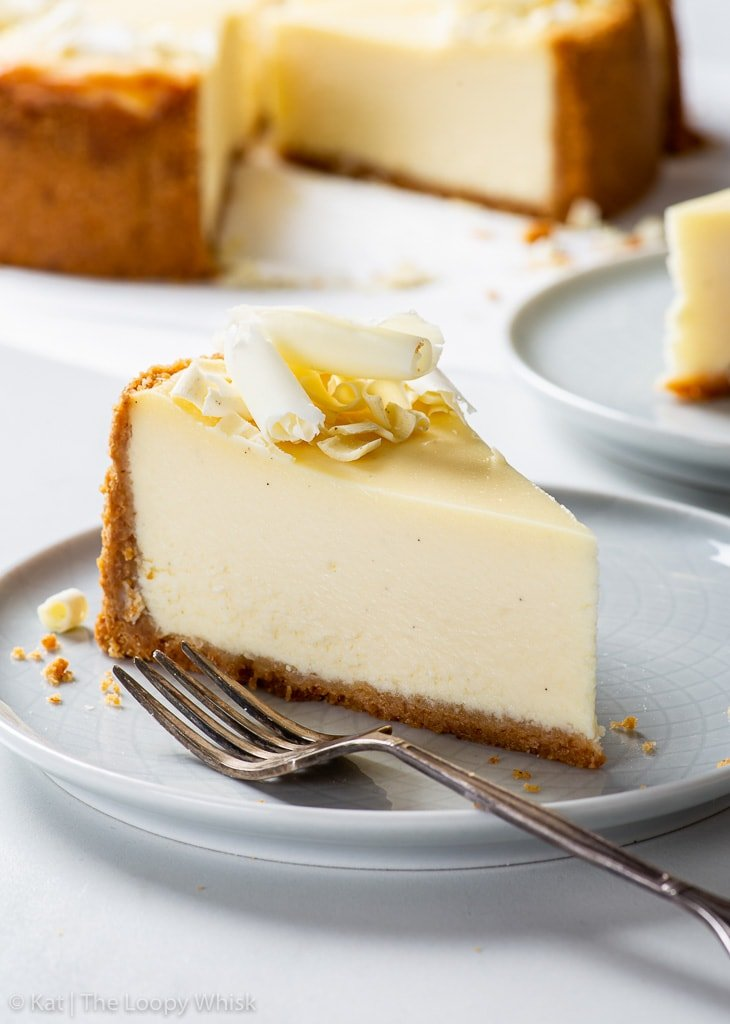 A slice of white chocolate cheesecake on a light blue dessert plate.