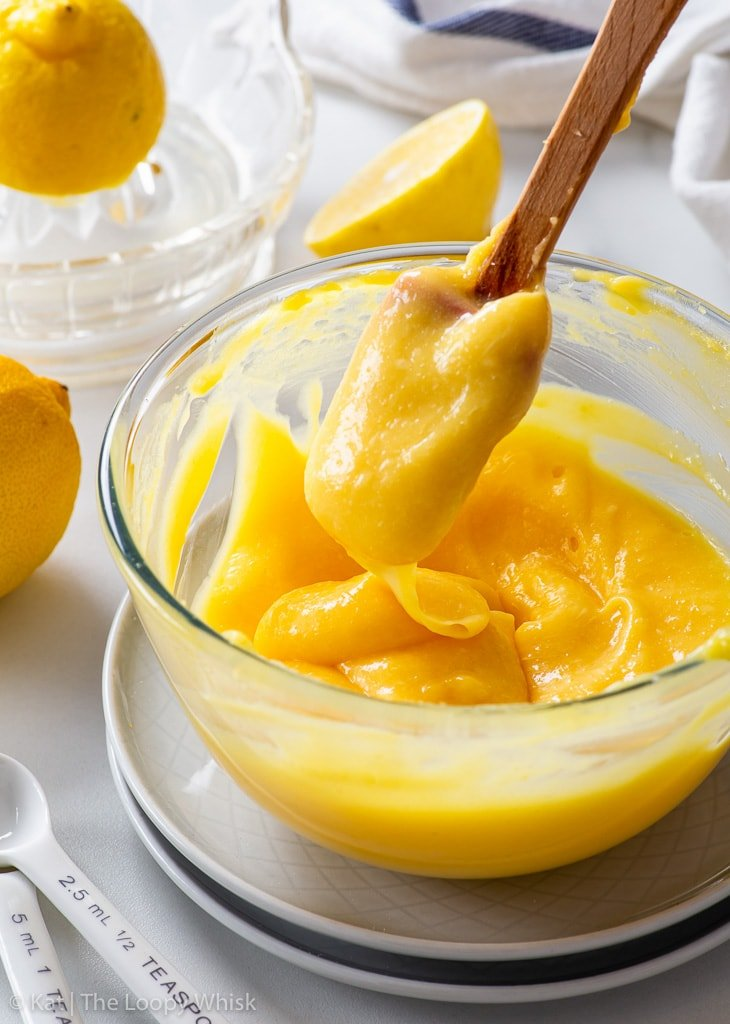 Lemon curd in a small glass bowl.