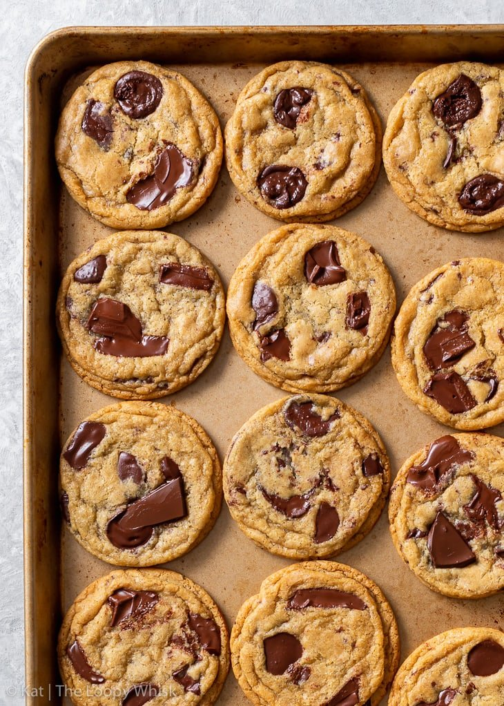 Overhead view of gluten free chocolate chip cookies on a baking tray.