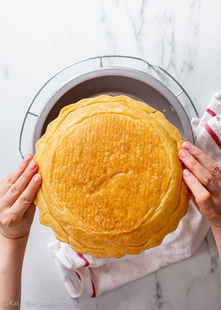 Showing the golden brown underside of the baked pie crust.