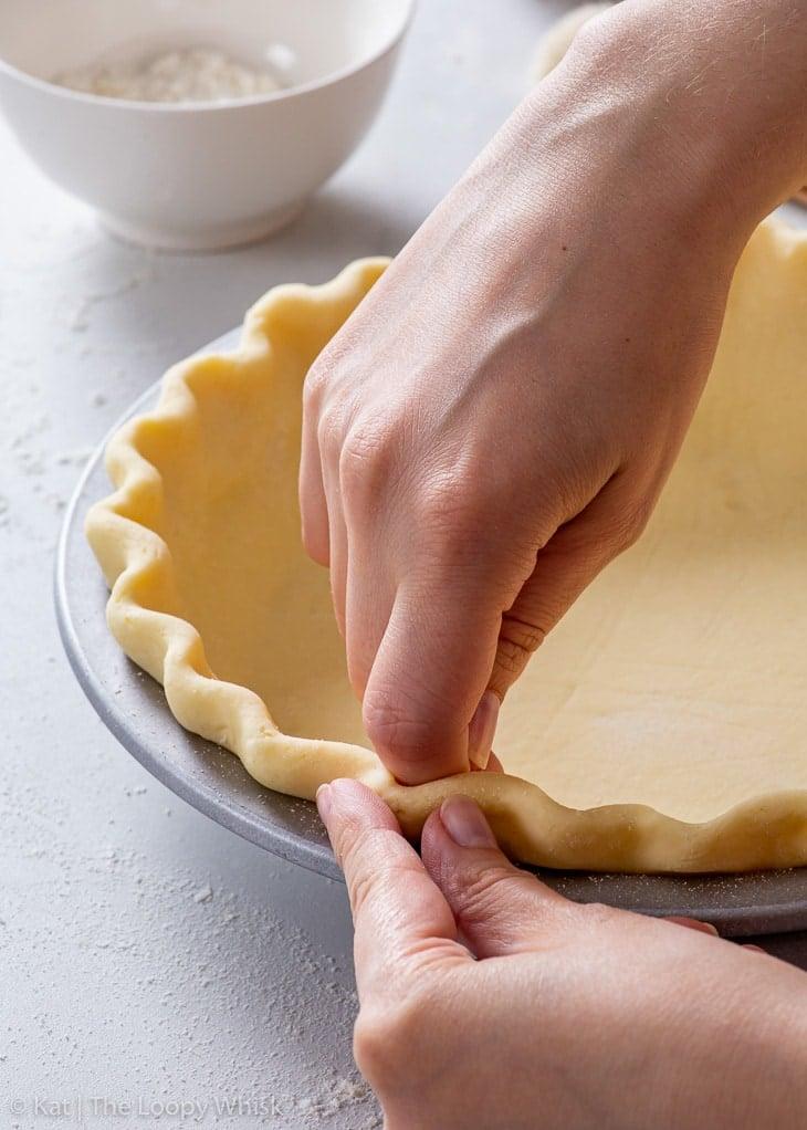 Crimping the edge of the gluten free pie crust.