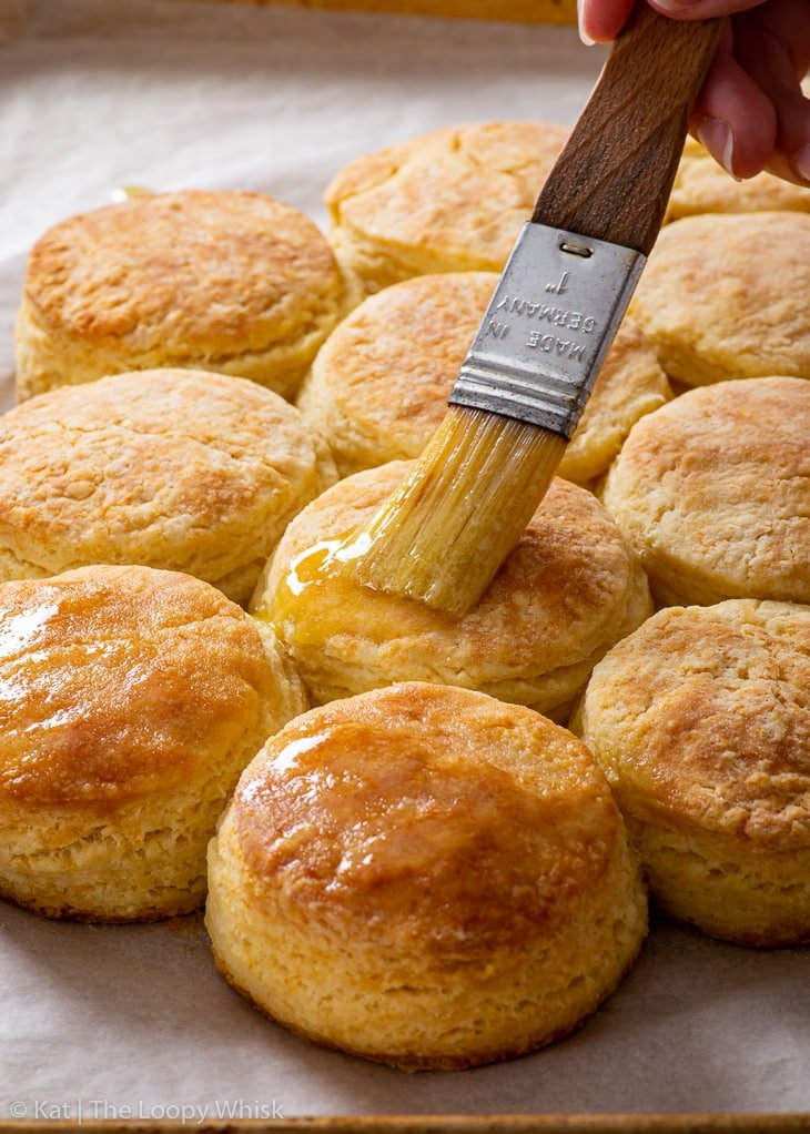 Brushing gluten free biscuits with melted butter.