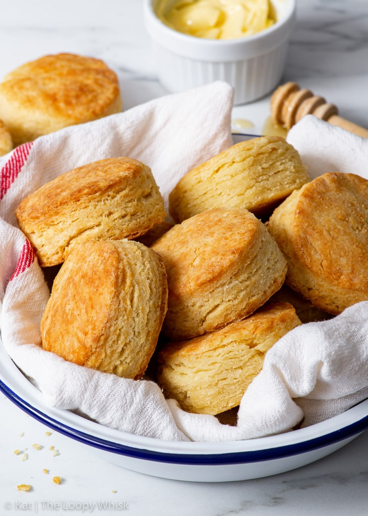 Gluten free biscuits in a dish towel lined bowl.