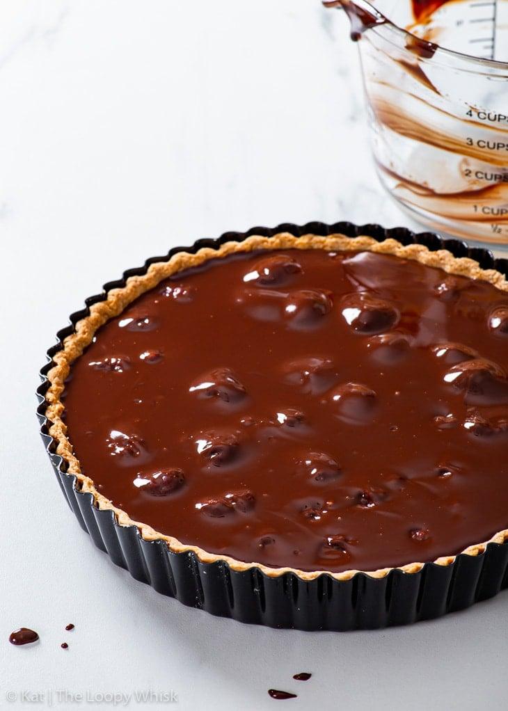 The vegan chocolate & raspberry tart before chilling.