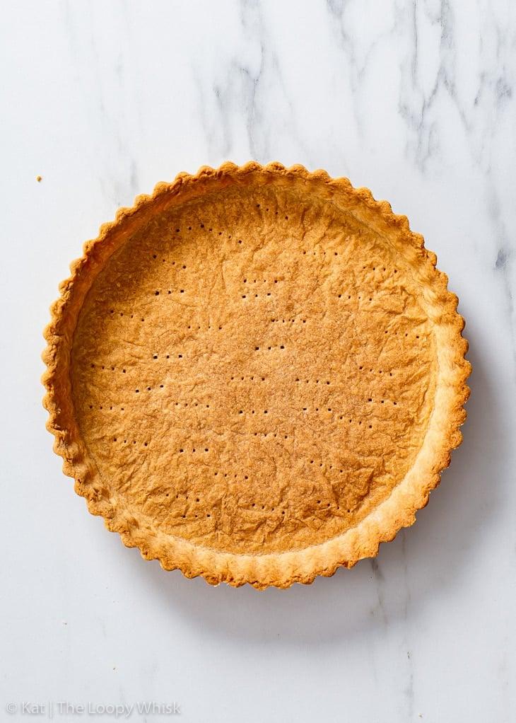 Overhead view of blind baked vegan shortcrust pastry.
