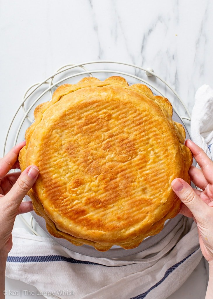 Showing the golden brown underside of the blind-baked pie crust.