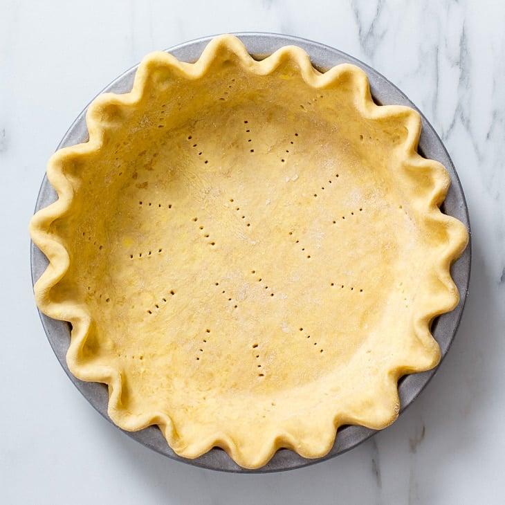 Overhead view of the vegan pie crust before baking.