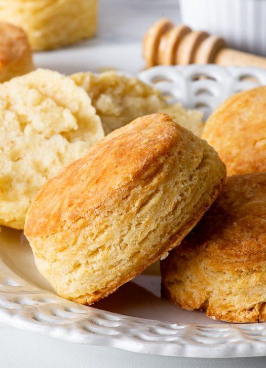 Gluten free biscuits on a white dessert plate.