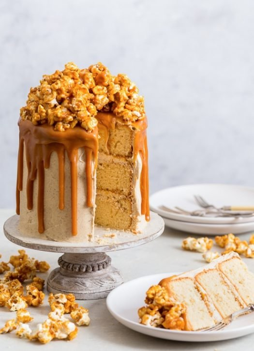 Salted Caramel Popcorn Cake (Gluten Free) - [SPONSORED] This salted caramel popcorn cake quite simply will blow your mind. With soft peanut butter sponges, insanely delicious brown butter frosting, an overabundance of salted caramel sauce and a small mountain of caramel popcorn. Plus, it's gluten free. Sounds rather perfect, doesn't it? Gluten free cake. Easy cake recipes. Gluten free desserts. Celebration cake ideas. Cake decoration. #glutenfree #cake #dessert #caramel #popcorn #recipe #food
