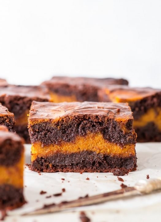 Extra Fudgy Pumpkin Brownies (Gluten Free) - Perfectly fudgy, swirled through with a spice-filled pumpkin pie filling AND easy to make – there's nothing not to love about these amazing pumpkin brownies. If you're looking for your new favourite fall dessert… look no further. Pumpkin dessert recipes. Autumn recipes. Fall recipes. Pumpkin recipes. Pumpkin pie filling. Gooey brownies. Fudgy brownies recipe. Gluten free brownies. Gluten free desserts. #brownies #pumpkinpie